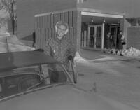 Woman getting out of her car at Mankato State College, 1963-01-16.