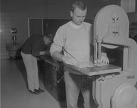 Students working on saws in Industrial Arts shop at Mankato State College, 1963-01-29.