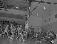Basketball player taking a shot against Moorhead at Mankato State College, 1963-01-29.