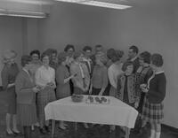 Nursing students around table with apples at Mankato State College, 1963-01-29.