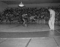 Mankato State College student, David Mauseth, in Wrestling Meet against SCI, 1963-01-29.