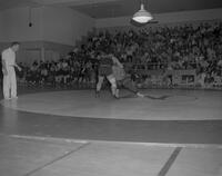 Mankato State College student in Wrestling Meet against SCI, 1963-01-29.