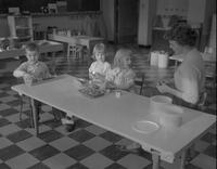 Child Development student supervising children playing at Mankato State College, 1963-01-29.