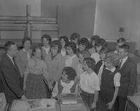 Group of students with professor at Mankato State College, 1963-02-08.