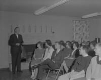 Man speaking to Mankato State College students, 1963-02-18.