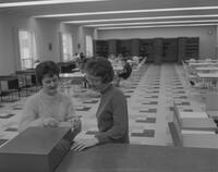 Mankato State College students consulting card catalog at Lincoln Library, 1963-02-23.