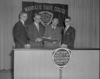 Mankato State College Physics professor John Scholmeier speaking at Engineering Club meeting,  1963-02-23.