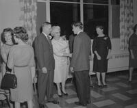 Mankato State College President, C. L. Crawford, and other faculty meeting students at Freshman Tea Party, 1961-09-26.