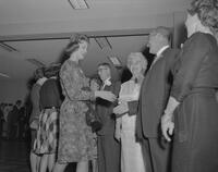 Dr. and Mrs. Crawford standing in reception line at Freshman Tea Party, 1961-09-28.