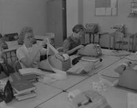 Mankato State College business department students using an adding machine, 1961-10-03.