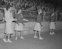 Cheerleaders at Mankato State College, cheering on their team, 1961-10-09.