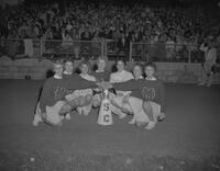 Cheerleaders posed at a Football game at Mankato State College, 1961-10-09.