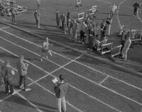 Track athlete, Towey, finishing race, Mankato State College, 1961-10-23.