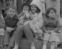 Four children watching the Homecoming parade at Mankato State College, 1961-10-31.