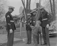 Four Color Guard men showing young boy a rifle at Mankato State College, 1961-10-31.