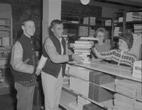 Two men getting textbooks at the bookstore at Mankato State College, 1961-10-30.