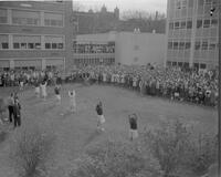 Cheerleaders leading walkout cheer at Mankato State College, 1961-10-31.