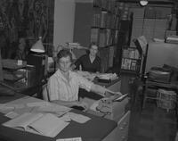 Mrs. Andersen at desk in bookstore at Mankato State College, 1961-11-01.
