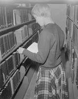 Woman in the Periodical section at Mankato State College, 1961-11-01.