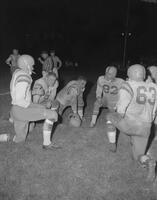 Huddle during Football game against Michigan Tech, Mankato State College, 1961-11-06.