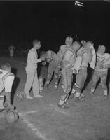 Shirley, Amos, Sylvester, etc. during timeout of Football game against Michigan Tech, Mankato State College, 1961-11-06.