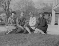 Four students posing for a picture, Mankato State College, 1961-11-09.