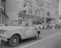Mankato State College Cheerleaders in homecoming parade, 1961-11-20.