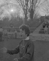 Sue Halos cheering at Football Game at Mankato State College, 1961-12-05.