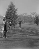 Doug Laird running at Minneopa cross country meet, Mankato State College, 1961-12-05.