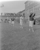 Cheerleaders at Mankato State College leading a cheer at walkout, 1961-11-27.