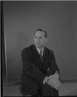 Man sitting for a portrait, Mankato State College? 1960-01-06?.