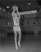 Basketball player, Jerry Flanagan practicing, Mankato State College, 1960?
