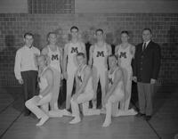 Group photo of the '61-'62 gymnastics team. Mankato State College. 1961-12-12.