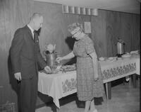 German Instructor Mrs. Vilhelmine-Koufmanis serving tea to a student at the Russian Club Christmas party. Mankato State College. 1962-01-02.