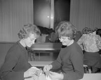 Two students working on sewing projects. Mankato State College. 1962-01-02.