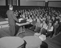 Man giving a lecture to students. Mankato State College. 1962-01-02.