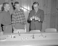 German Club  Members preparing for Christmas party in the Pine Room. Mankato State College. 1962-01-02.
