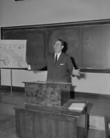 Professor giving lecture in classroom. Mankato State College. 1962-01-02.