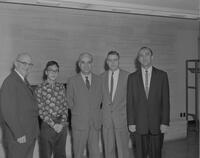 Dr. Meyering, a young man, Dr. Crawford, Recat Tardu, Dr. Crawford, and his interpreter at Mankato State College to observe the Special Education Department, 1962-01-02.