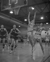 Action shot of Men's Basketball game at Mankato State College, 1962-01-02.