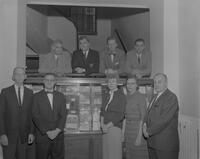 Faculty members at Mankato State College posed alongside illustrated books that they have had published, 1962-01-09.