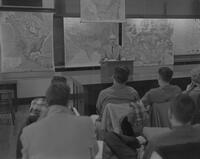 Dr. Bert Burns, professor of Geography at Mankato State College, lecturing to a class, 1962-01-12.