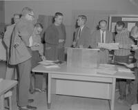 Math Club students at Mankato State College talking to advisers, W. Thompson and D. Turner, 1962-01-12.