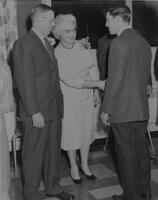 Dr. and Mrs. Crawford greet a freshman boy at freshman tea. Mankato State College. 1962-01-02.