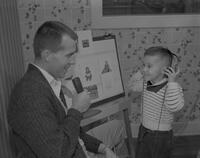 Lyle McFarling, Speech Pathology student, giving hearing test to a child at Mankato State College, 1961-12-05.