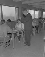 Director of Library Services, Donald B. Youel, chatting with students at Mankato State College, 1962-01-15.