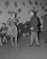 Man and woman dancing as a couple at the Fall Formal at Mankato State College, 1961-12-05.
