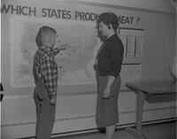 Student teacher with child looking at US map at Wilson Campus School, Mankato State College, 1961-02-02.