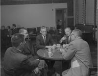 Faculty sitting at a table in the lounge at Mankato State College, 1962-01-02.
