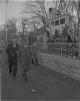 Crowd, including President Crawford, leaving a sporting event, Mankato State College, 1962-01-02.